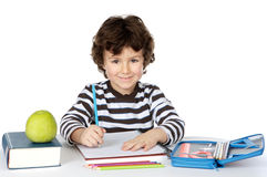 Adorable boy studying. A over white background Stock Photos