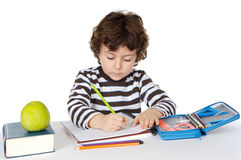 Adorable boy studying. A over white background Royalty Free Stock Photography
