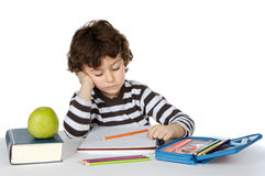Adorable boy studying. A over white background Stock Images