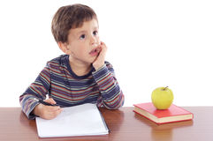 Adorable boy studying. A over white background Royalty Free Stock Images