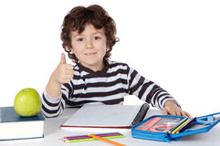 Adorable boy studying. A over white background Royalty Free Stock Photos