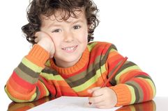 Adorable boy studying. A over white background Royalty Free Stock Photo
