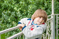 Adorable boy in summerhouse Stock Image