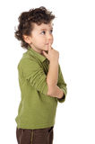 Adorable boy thinking. Photo of an adorable boy thinking a over white background Royalty Free Stock Photo