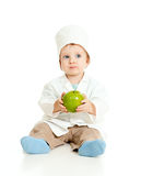 Adorable boy uniformed as doctor with green apple. Adorable boy uniformed as doctor with healthy food over white Royalty Free Stock Images