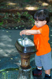 Adorable Boy At Water Fountain Stock Image