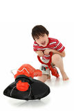 Adorable Boy with Weed Whacker Stock Images