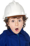 Adorable boy worker with surprise gesture Stock Photos
