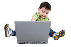 Adorable Boy Working On Laptop Over White Stock Photo