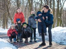 Adorable boys in winter park royalty free stock image