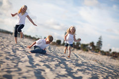 Adorable Brother and Sisters Having Fun at the Beach Stock Photography