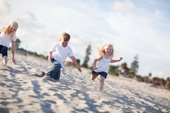 Adorable Brother and Sisters Having Fun at the Beach Stock Photos