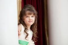 Adorable brown-eyed girl posing looking at camera Stock Photo