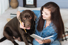 Adorable brown Labrador helping writing a list Stock Photo