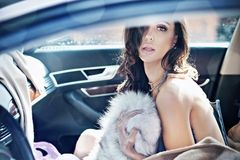 Adorable brunette in a car Stock Photo