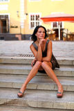 Adorable brunette with sexual legs in Old Riga Royalty Free Stock Photos