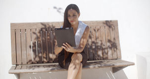Adorable Business Woman Working on Tablet Royalty Free Stock Image