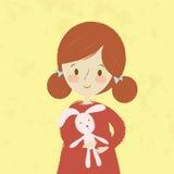 Adorable cartoon little girl with Easter bunny rabbit doll. Stock Photos