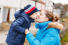 Adorable caucasian little boy and mother hugging on bridge, outd Royalty Free Stock Photography
