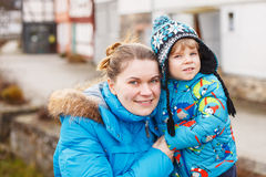 Adorable caucasian little boy and mother hugging on bridge, outd Royalty Free Stock Photos