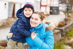 Adorable caucasian little boy and mother, outdoors Royalty Free Stock Image