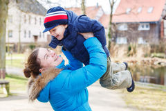 Adorable caucasian little boy and mother, outdoors Stock Image