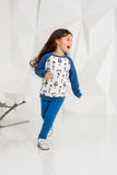 Adorable caucasian 5 year old girl running in white studio Stock Photos