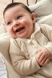 Adorable Cheerful baby of four months Royalty Free Stock Photography