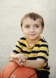 Adorable child with  the basketball Stock Photography