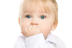 Adorable child with big blue eyes Stock Photo