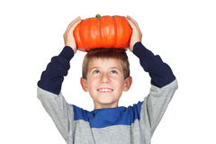 Adorable child with a big pumpkin Royalty Free Stock Photo