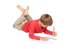 Adorable child with blond hair lying Royalty Free Stock Photo