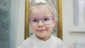Adorable child blonde girl wear glasses in ophthalmology clinic Stock Images