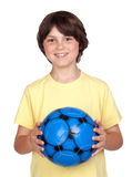 Adorable child with a blue soccer ball Stock Photography