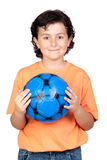 Adorable child with a blue soccer ball Royalty Free Stock Image