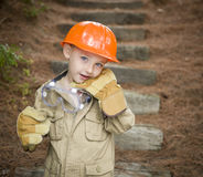 Adorable Child Boy with Big Gloves Playing Handyman Outside Royalty Free Stock Photo
