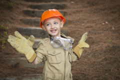 Adorable Child Boy with Big Gloves Playing Handyman Outside Stock Image