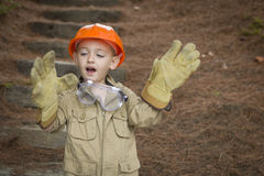 Adorable Child Boy with Big Gloves Playing Handyman Outside Royalty Free Stock Photography