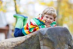 Adorable child boy having fun on autumn playground Stock Images
