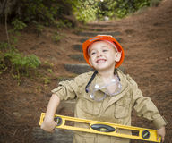Adorable Child Boy with Level Playing Handyman Outside Royalty Free Stock Images