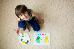 Adorable child, boy, preparing fathers day gift for dad Stock Image