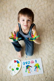 Adorable child, boy, preparing fathers day gift for dad Stock Images
