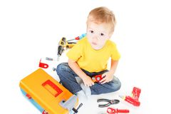 Adorable child boy with tools happy,  holding stock photo