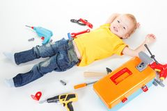 Adorable child boy with tools happy,  kid toy tools royalty free stock photo