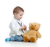 Adorable child with clothes of doctor Stock Image