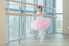 Adorable child dancing classical ballet in studio. Royalty Free Stock Photography