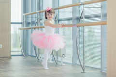 Adorable child dancing classical ballet in studio. Royalty Free Stock Images