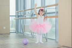 Adorable child dancing classical ballet in studio. Royalty Free Stock Photo
