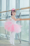 Adorable child dancing classical ballet in studio. Stock Photos
