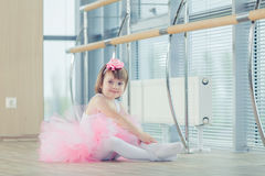 Adorable child dancing classical ballet in studio. Stock Photo